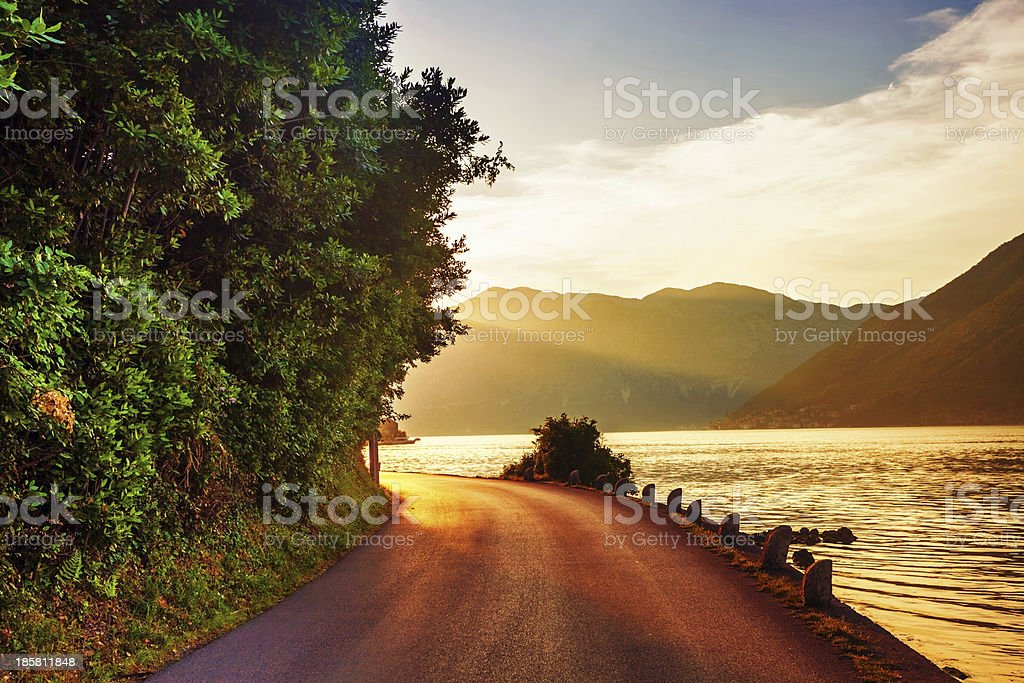 Sunset on the sea with foggy mountains royalty-free stock photo
