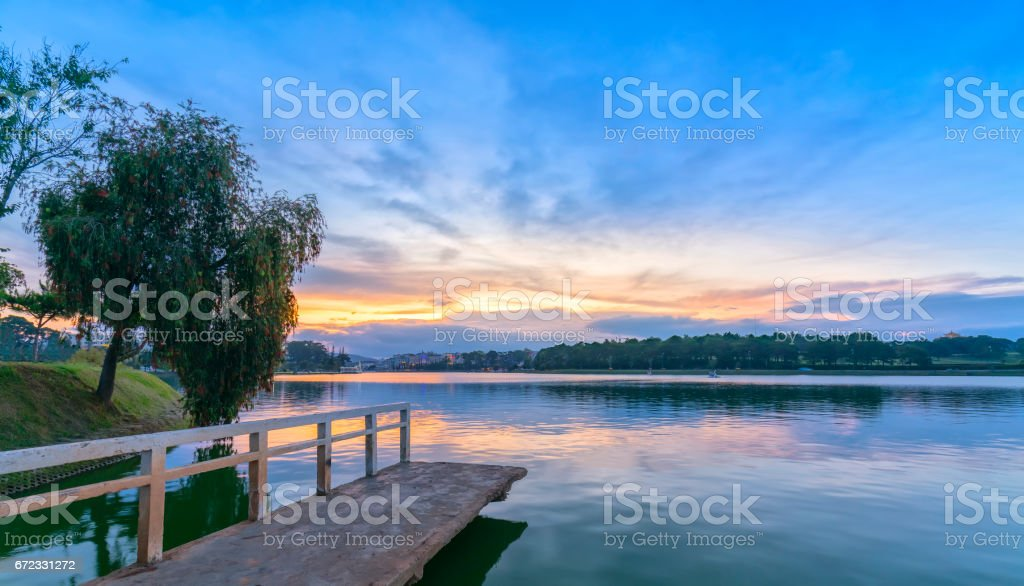 Sunset on the shores of Xuan Huong Lake stock photo