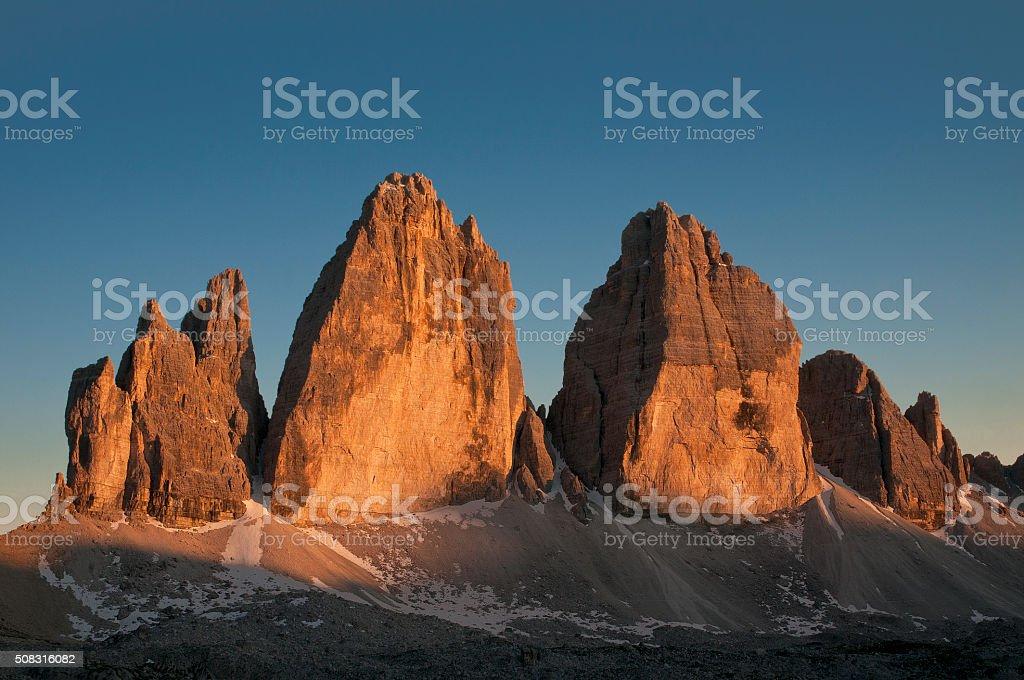 sunset on the three peaks of the Lavaredo Dolomite stock photo