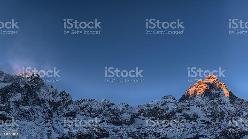 Sunset on the top of mountains stock photo