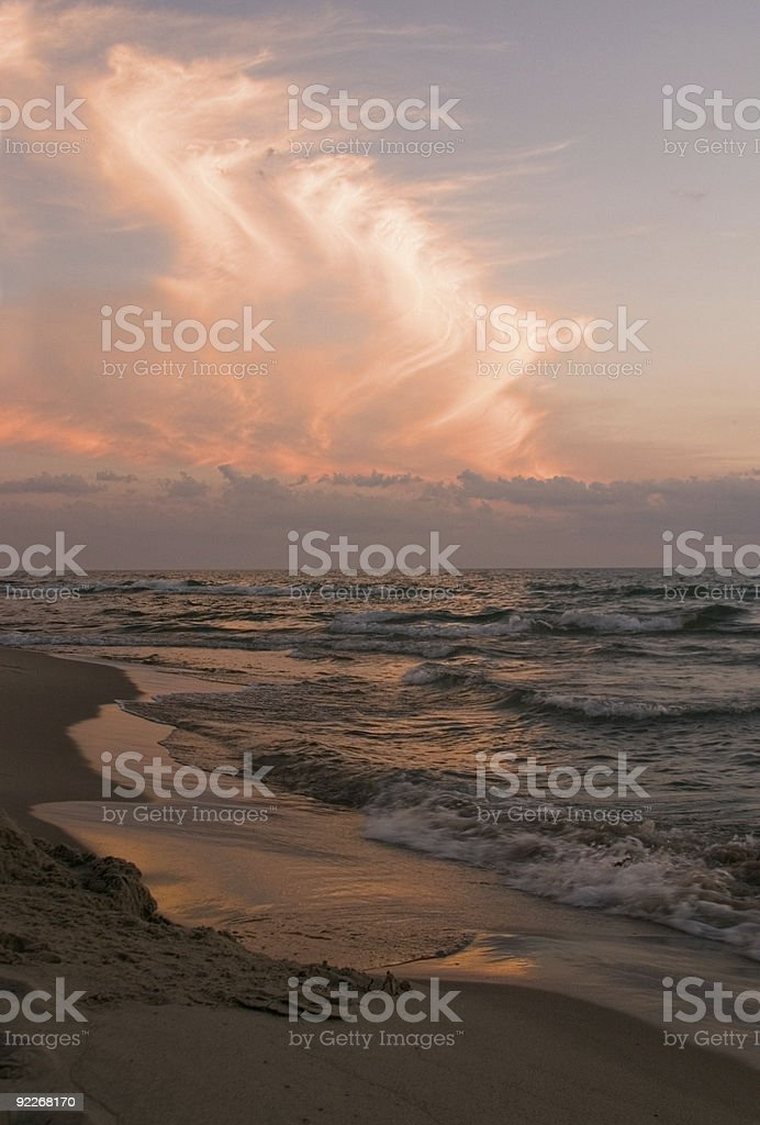 Sunset on the water - vertical royalty-free stock photo