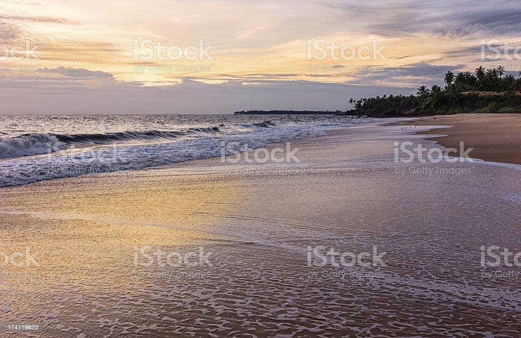 Sunset on Thottada beach, Kannur, Kerala, India. stock photo