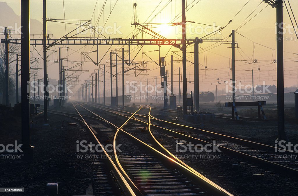 Sunset on train rails royalty-free stock photo