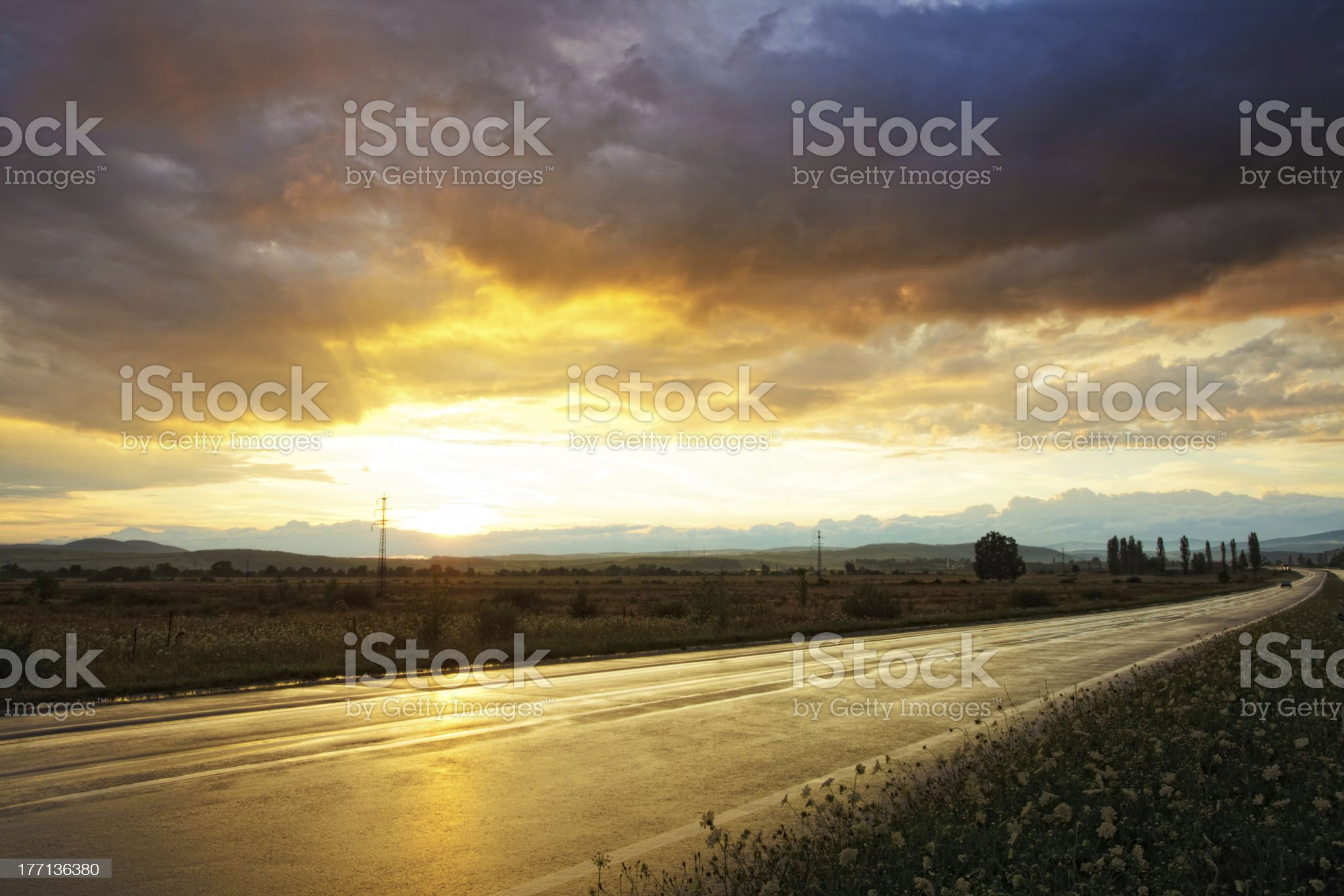 Sunset on wet road royalty-free stock photo