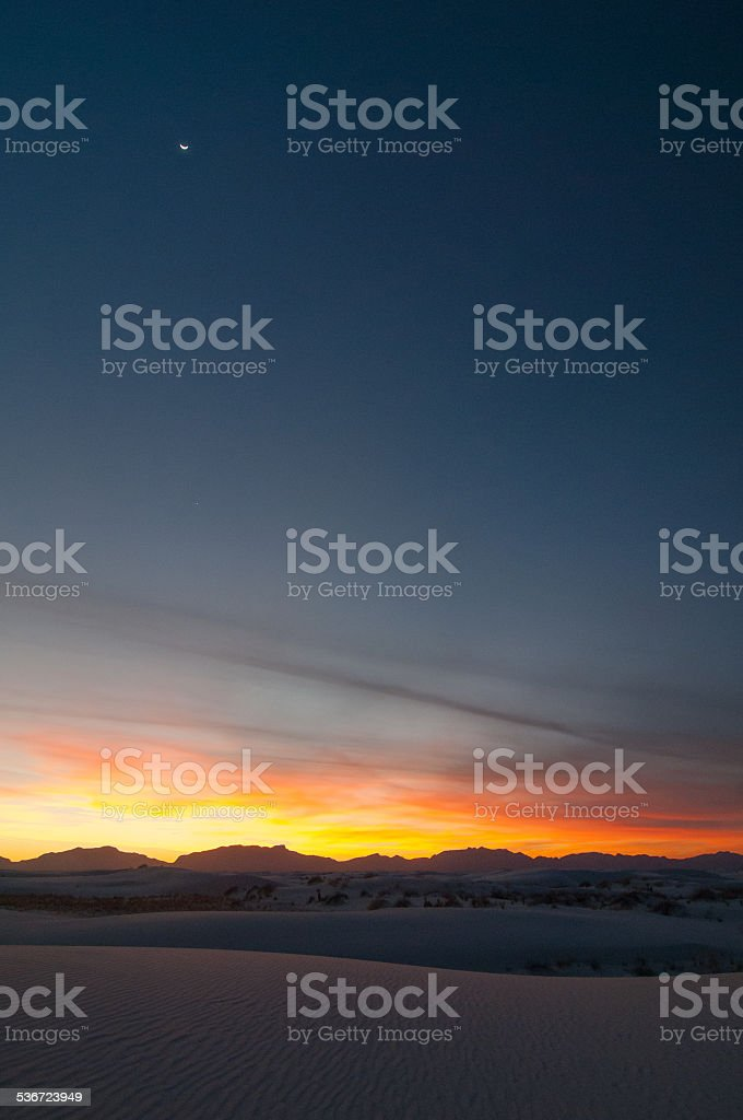 Sunset on with Moon at White Sands National Monument stock photo