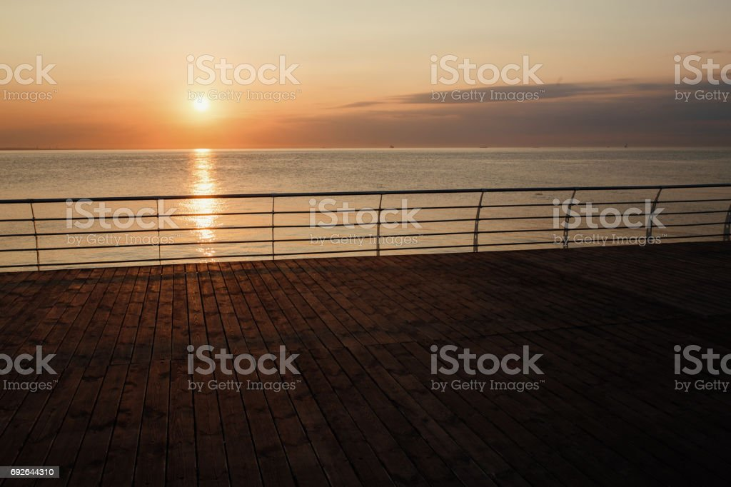 Sunset or sunrise from a ship or dock stock photo
