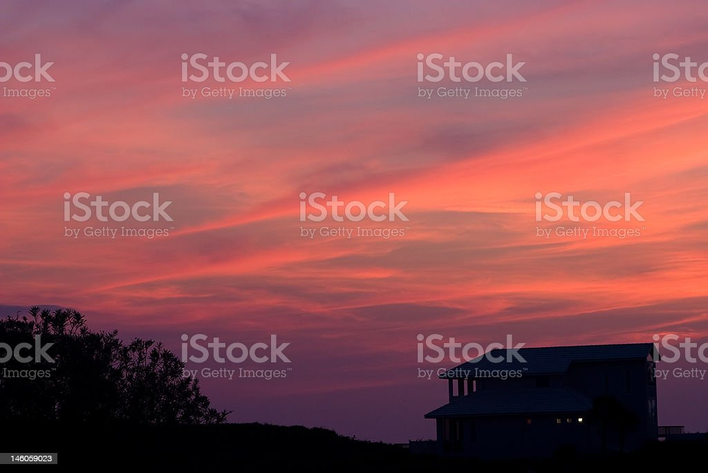 Sunset over a beach house royalty-free stock photo