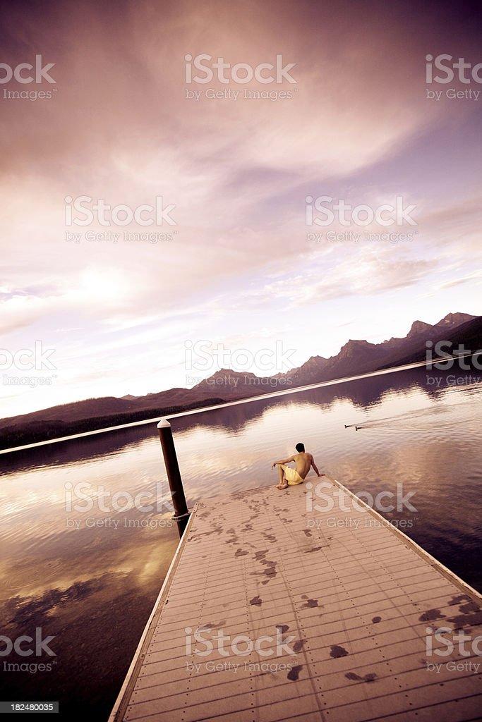 Sunset over a beautiful mountain lake stock photo