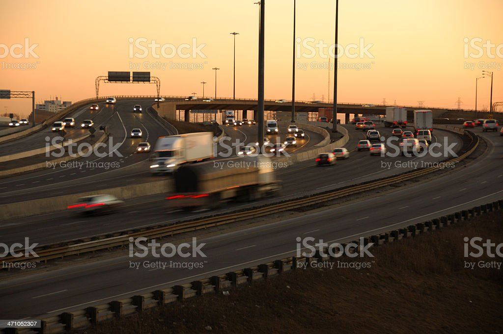 Sunset over a busy highway royalty-free stock photo