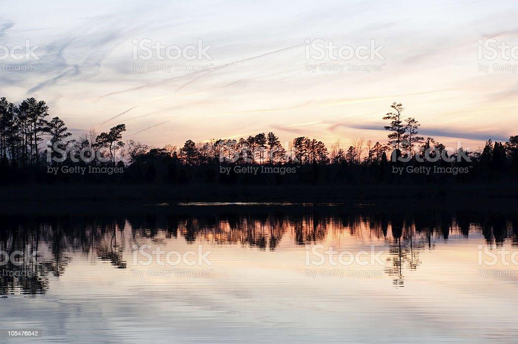sunset over a calm lake stock photo