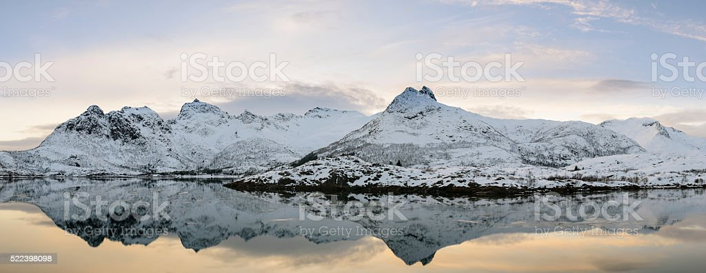 Sunset over a calm winter lake in Lofoten in Norway stock photo
