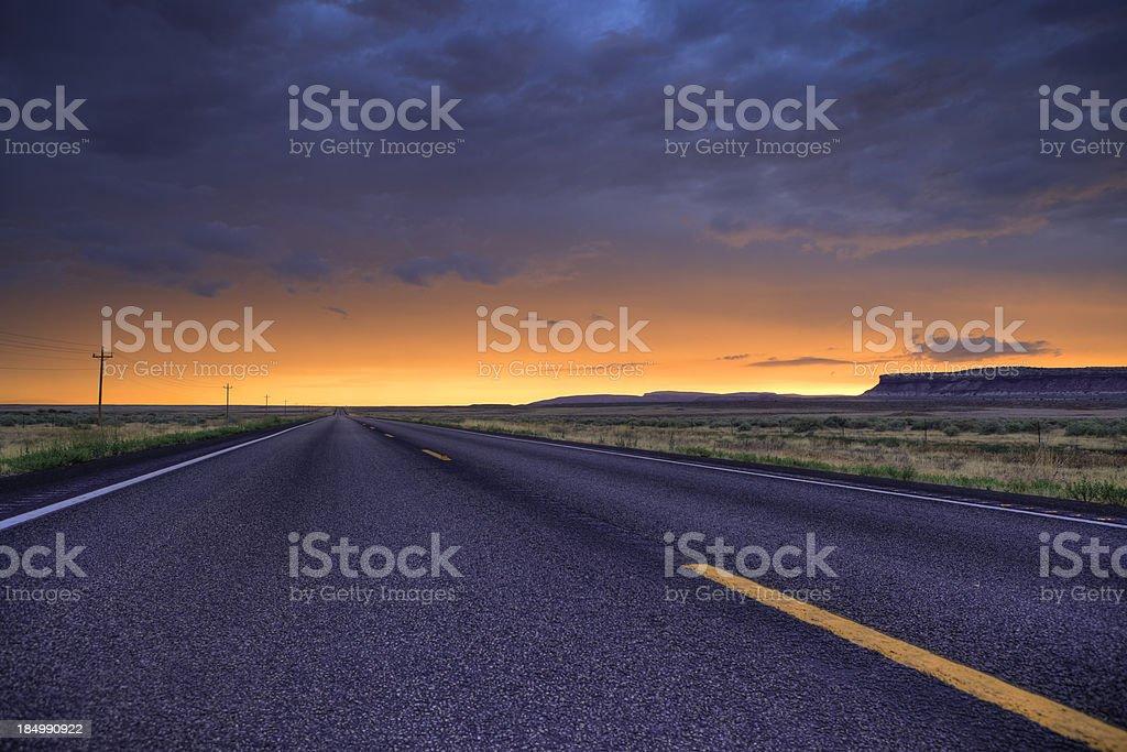 Sunset over a desert road in Utah stock photo