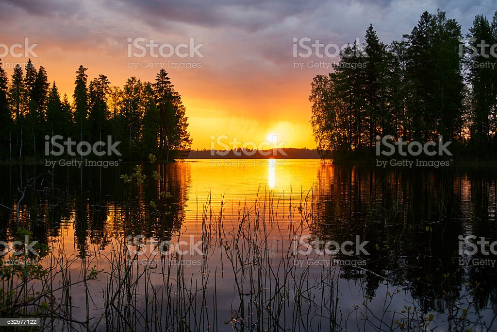 Sunset over a finnish lake stock photo