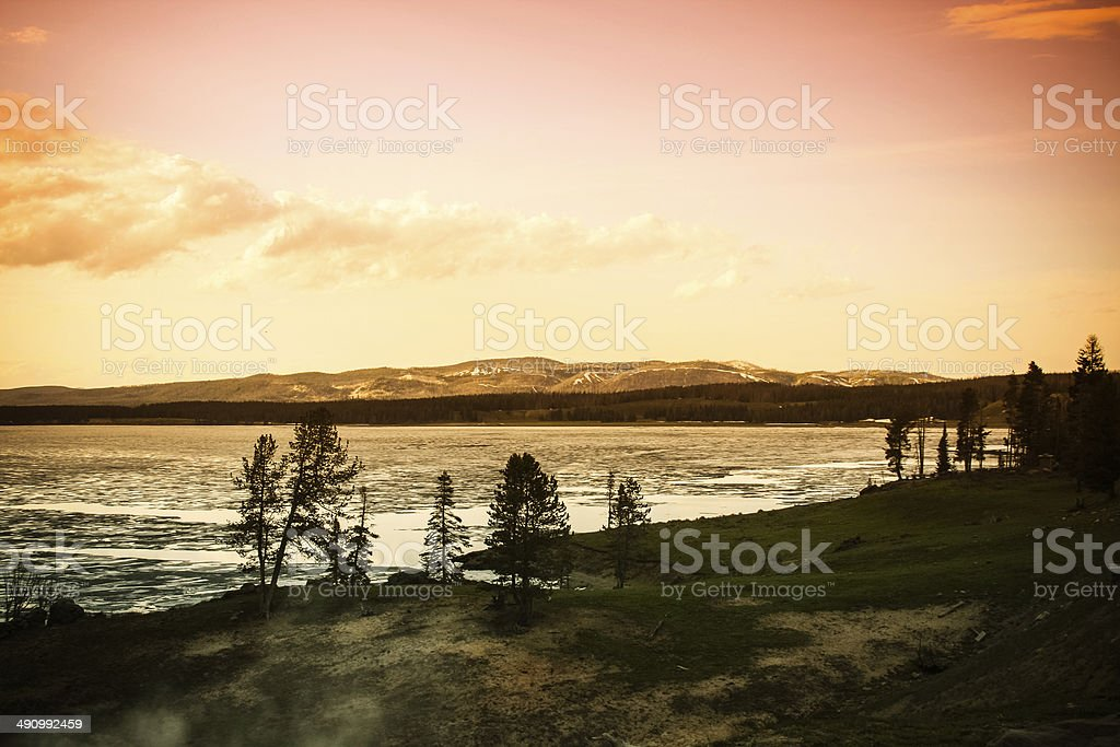 Sunset over a frozen lake in Yellowstone stock photo