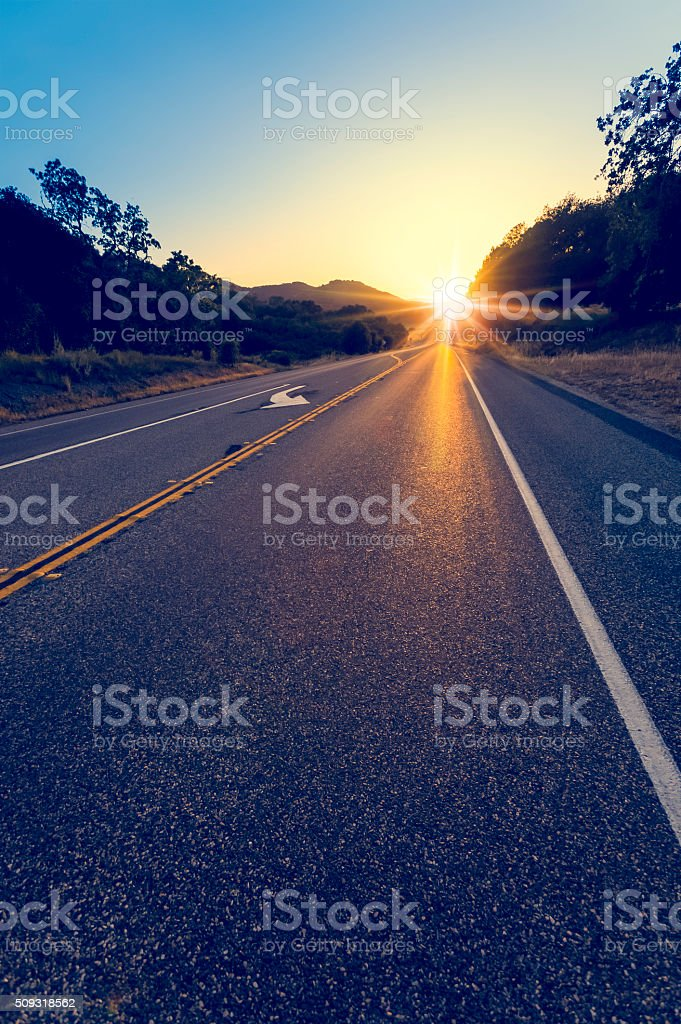 Sunset over a highway. stock photo