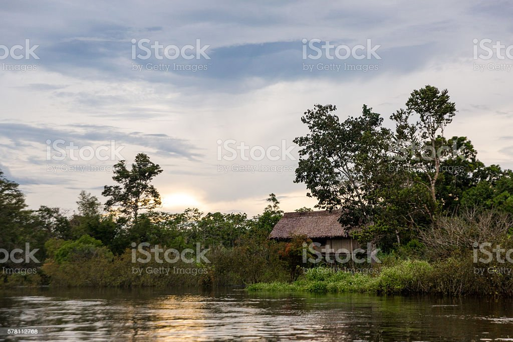 Sunset Over A Hut stock photo
