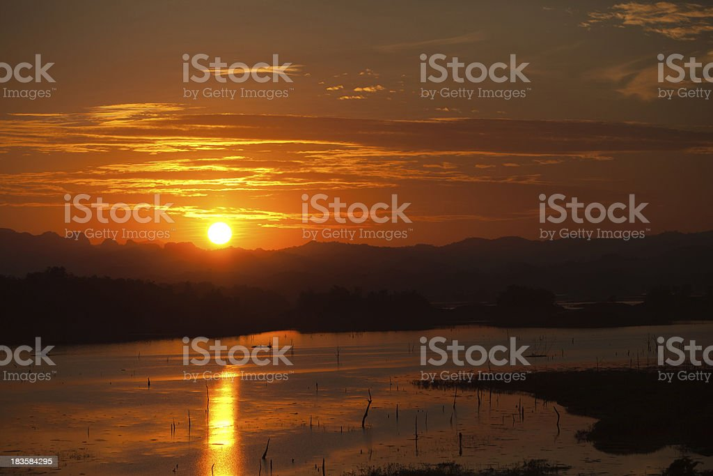 Sunset over a Lake with Mountains royalty-free stock photo