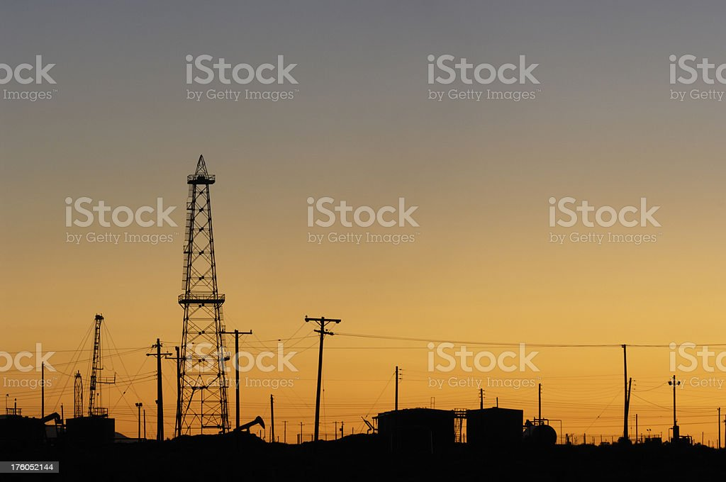 Sunset  over a oil field in California royalty-free stock photo