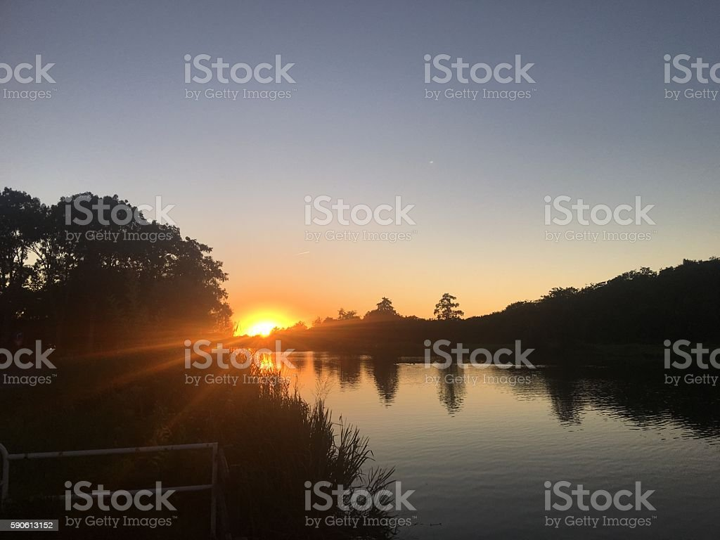 Sunset over a river stock photo