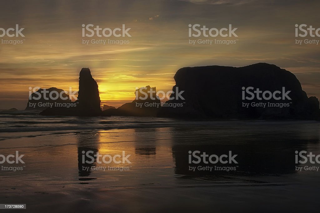 Sunset over a Rocky Shoreline stock photo