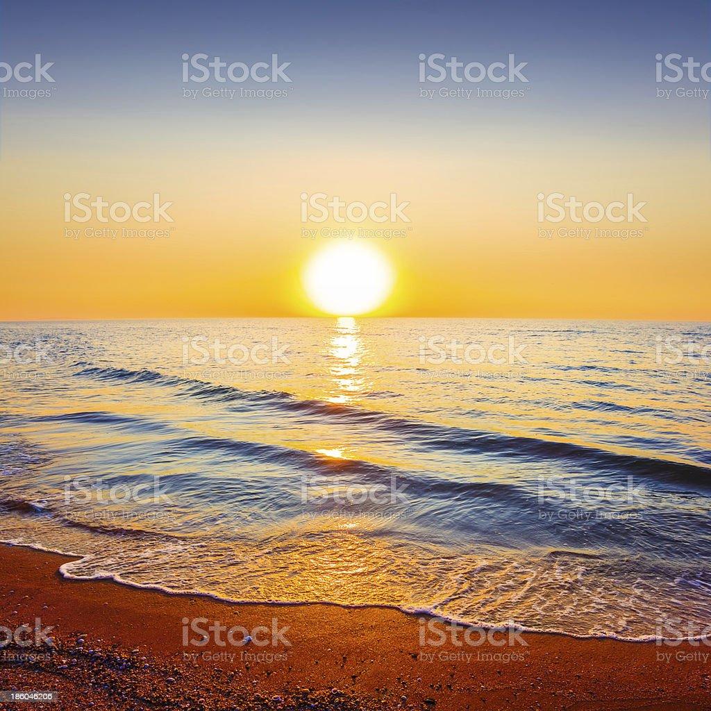 sunset over a sea coast royalty-free stock photo