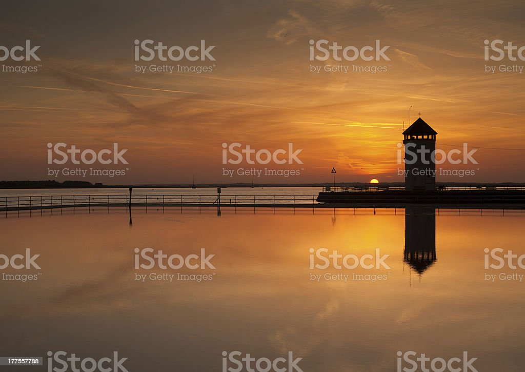 Sunset over a seaside watchtower stock photo