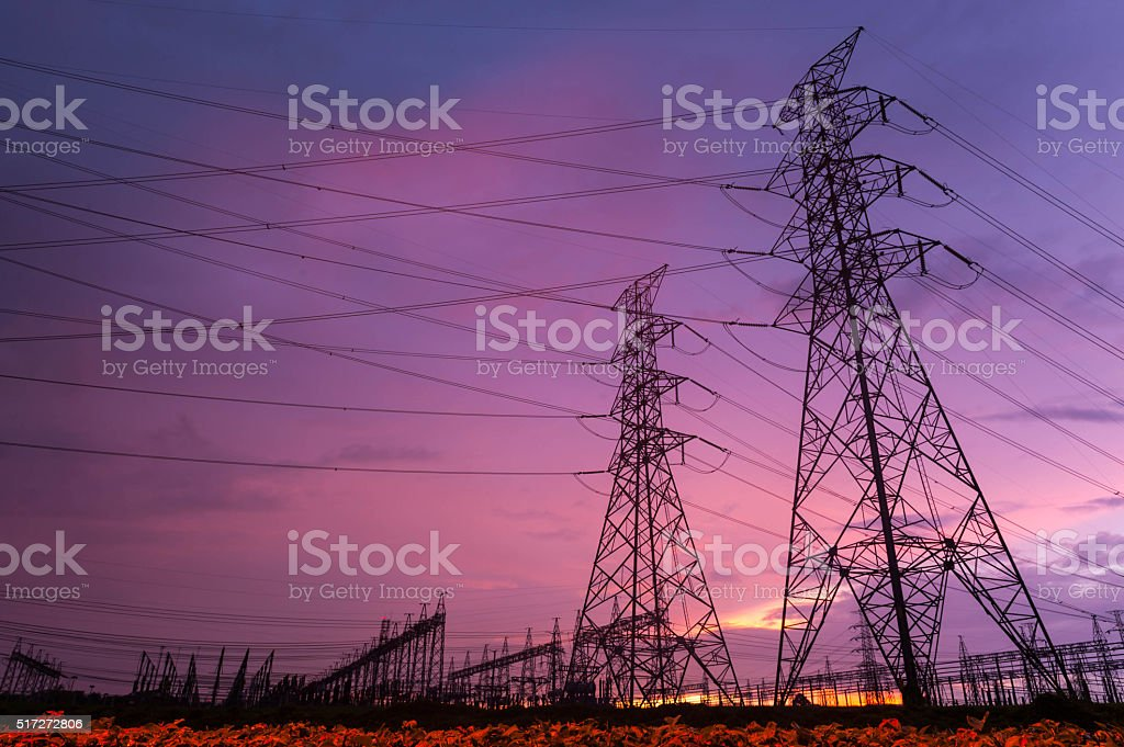 Sunset over a Silhouette electrical substation stock photo