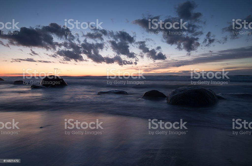 Sunset over a swedish beach stock photo