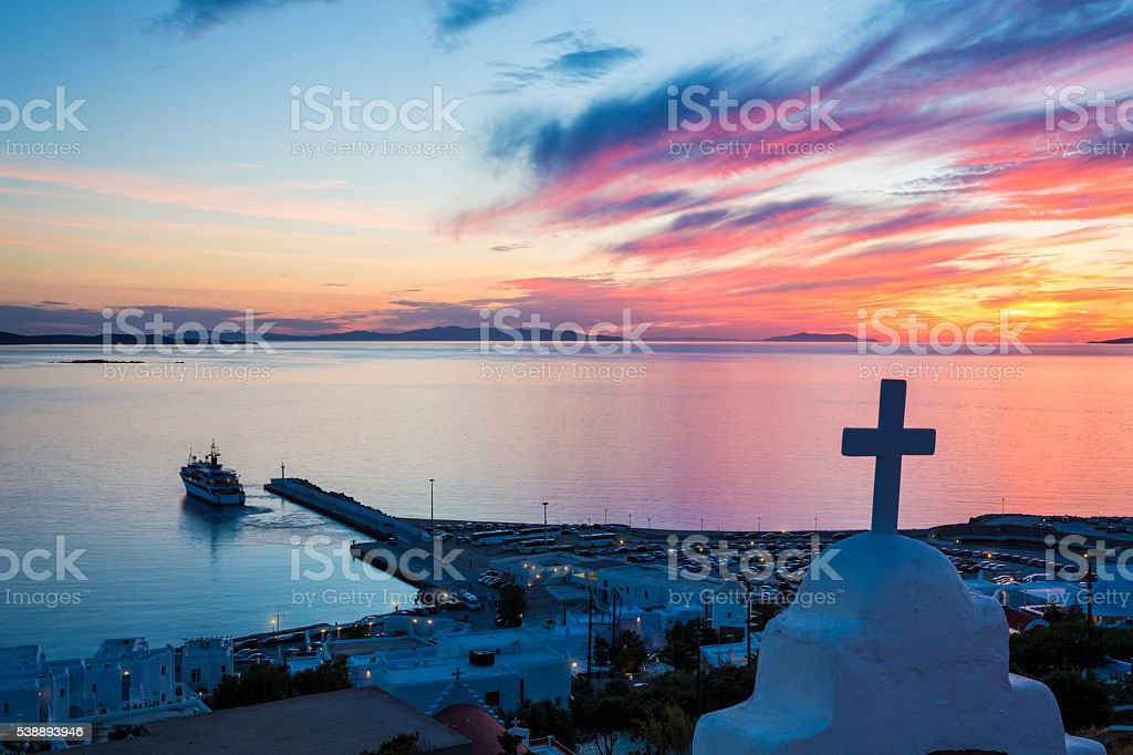 Sunset over Aegean Sea and Mykonos ferry terminal (Greece). stock photo