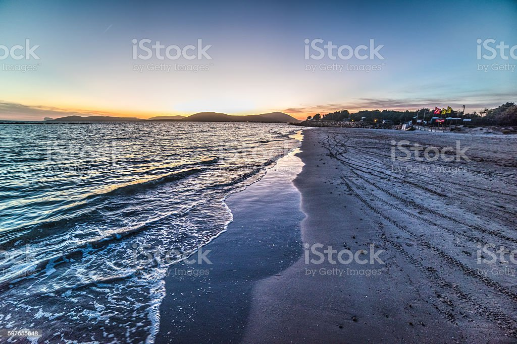 sunset over Alghero shoreline stock photo
