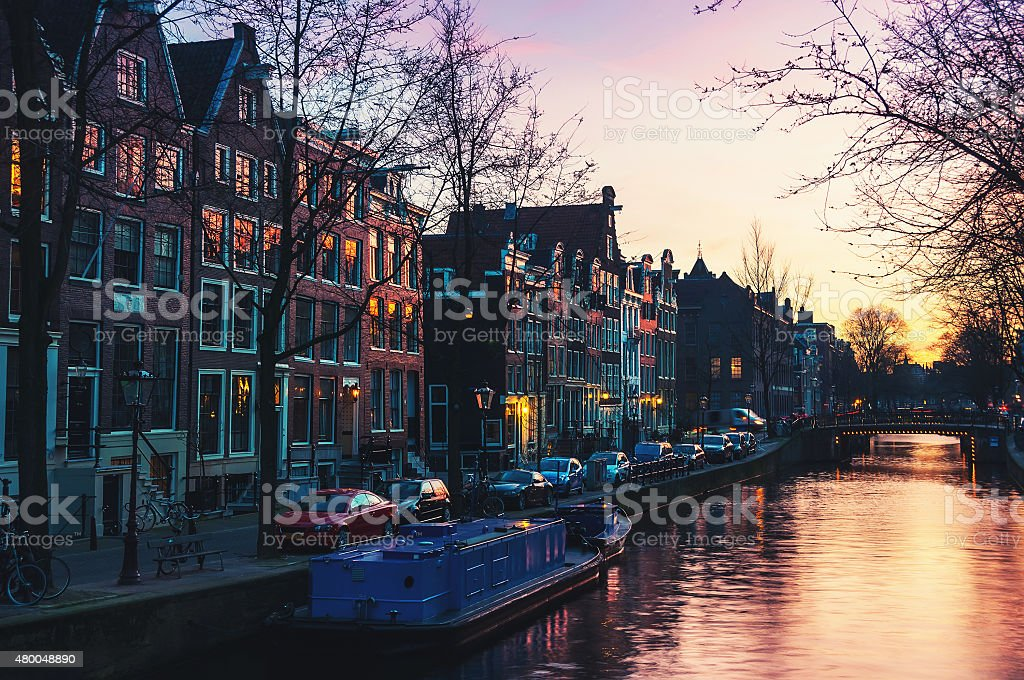 Sunset over Amsterdam, Netherlands canals and bridges stock photo