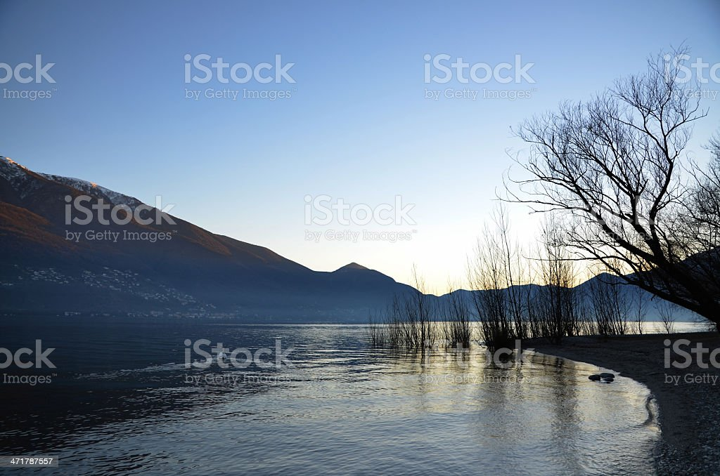 Sunset over an alpine lake royalty-free stock photo
