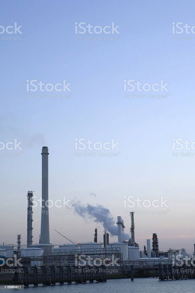 sunset over an oil refinery royalty-free stock photo