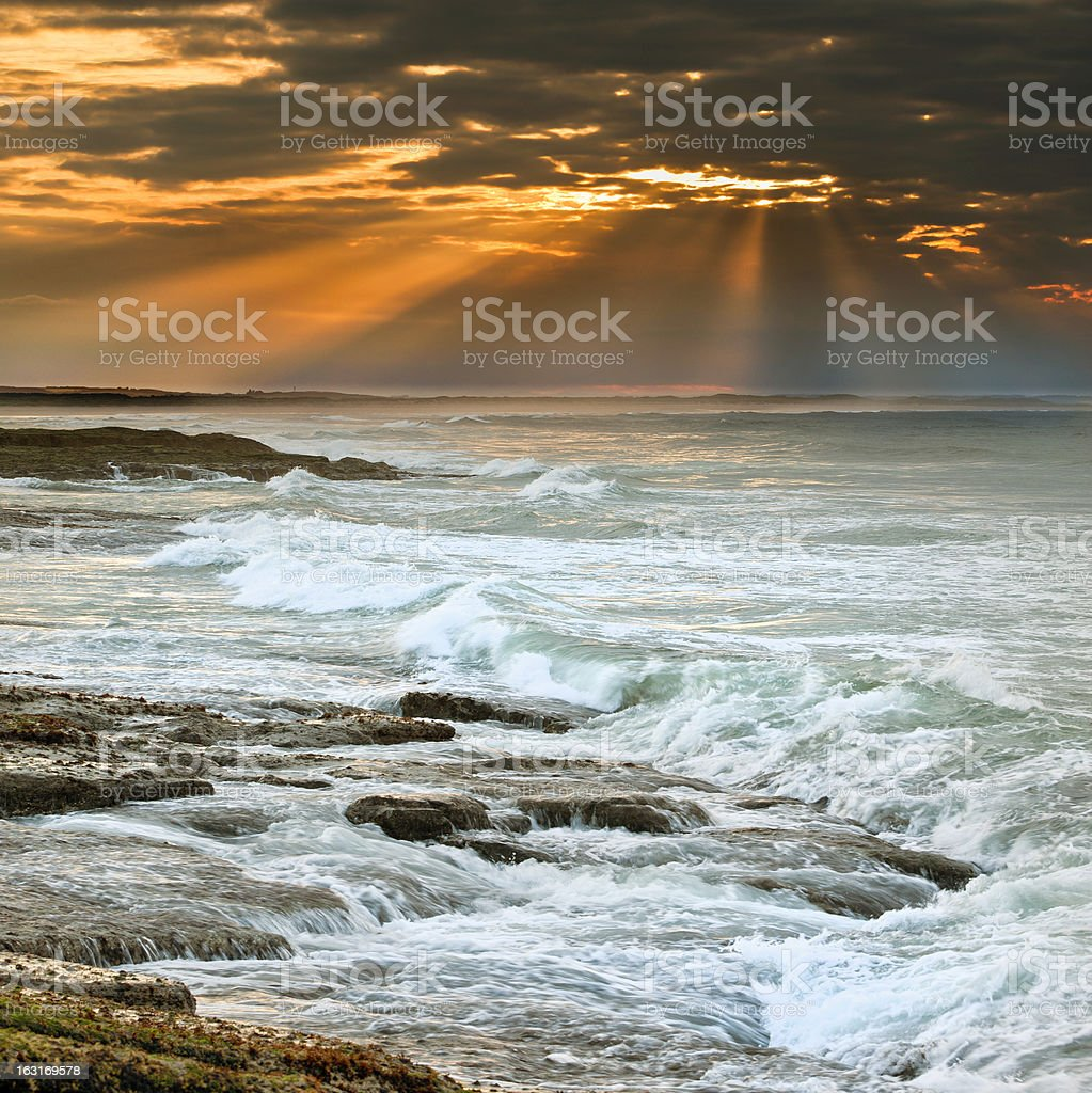 Sunset over Bamburgh beach royalty-free stock photo