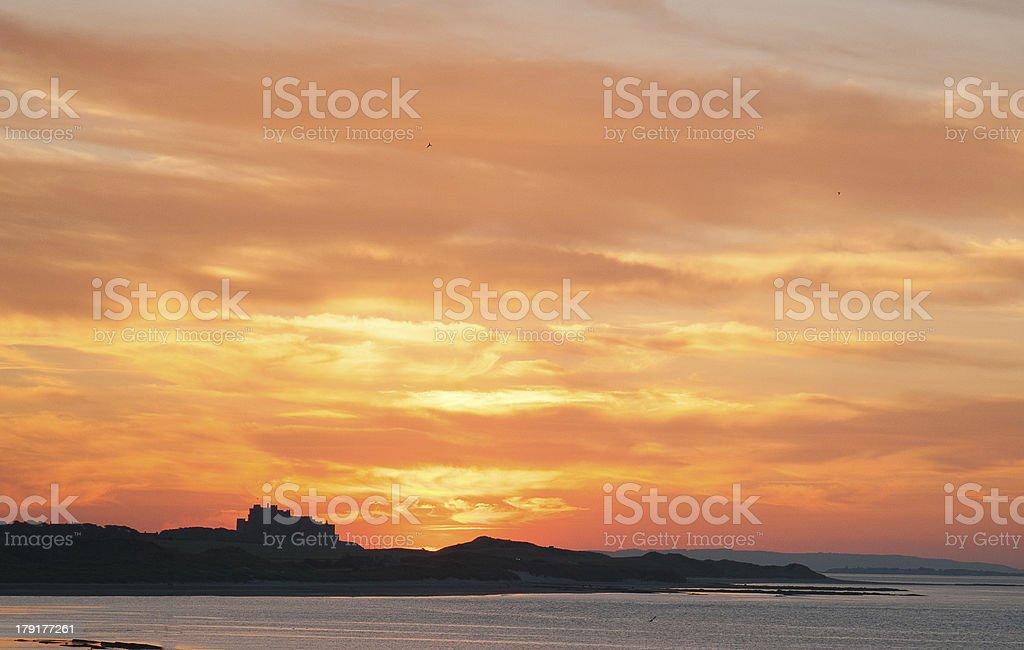Sunset Over Bamburgh Castle royalty-free stock photo