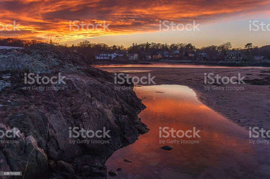 sunset over beach at low tide stock photo