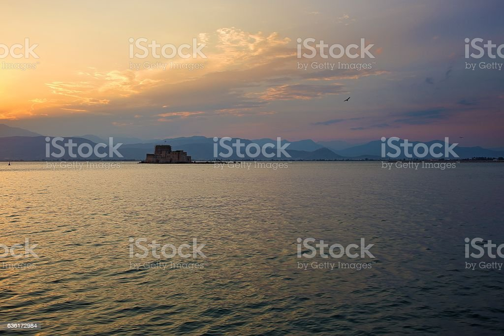 Sunset over Bourtzi castle in Nafplio, Greece. stock photo