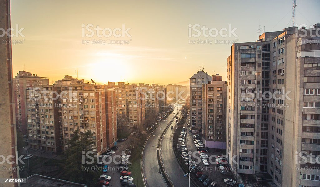 Sunset over buildings stock photo