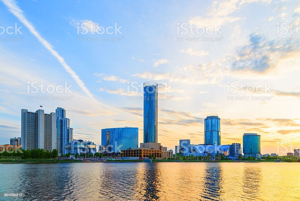 Sunset over business center of Yekaterinburg summer cloud sky sun stock photo