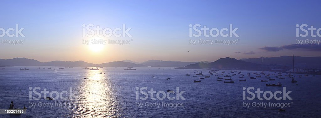 Sunset Over Busy Freight Port in Hong Kong stock photo