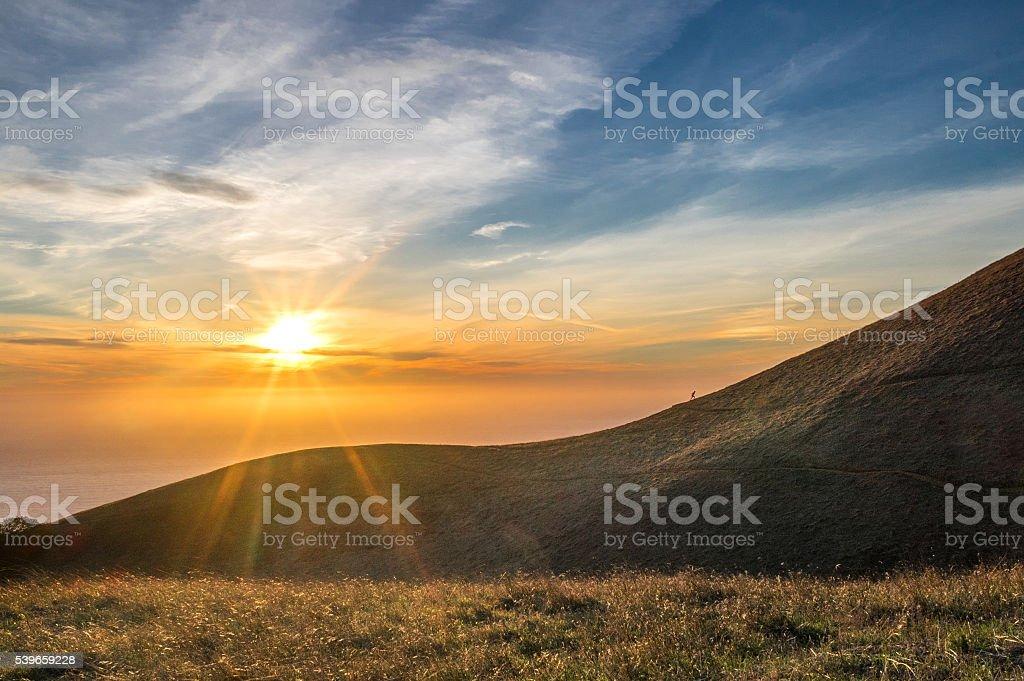 Sunset over California ocean, runner on hill at Mount Tamalpais stock photo