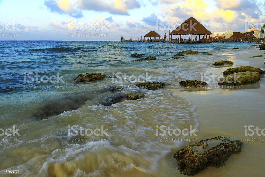 Sunset over caribbean beach and gazebo - palapa - Cancun stock photo