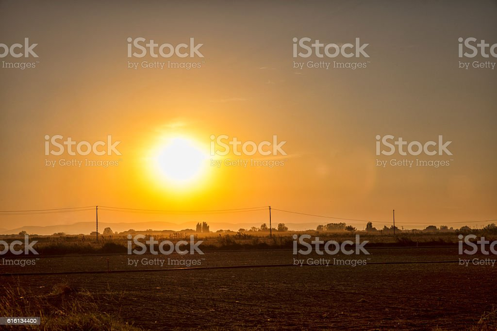 sunset over city stock photo