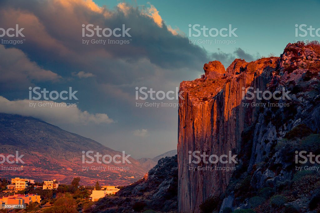 sunset over cliffs stock photo