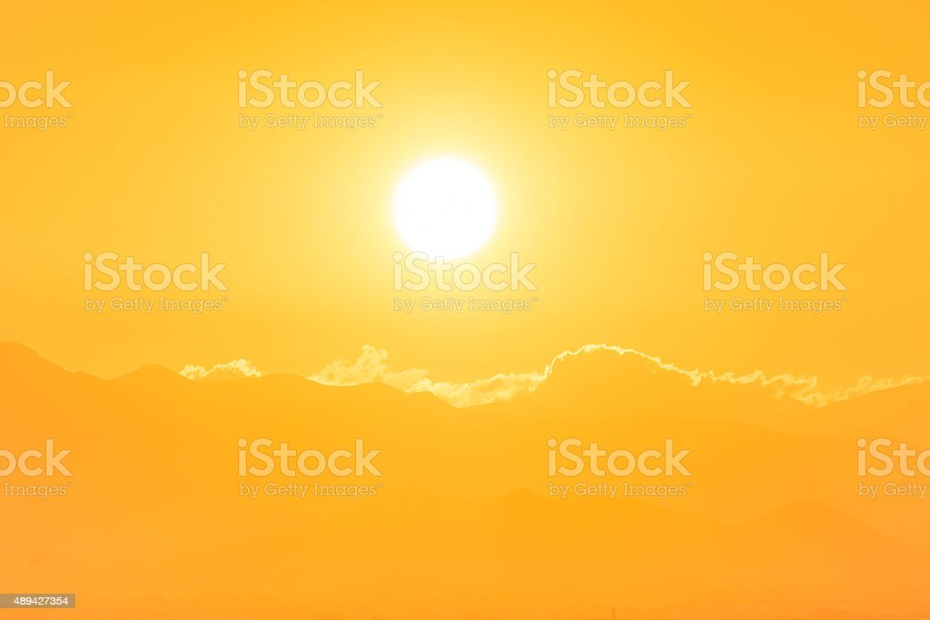 Sunset over clouds stock photo
