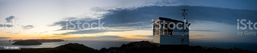 Sunset Over Coastguard Hut and Ocean royalty-free stock photo