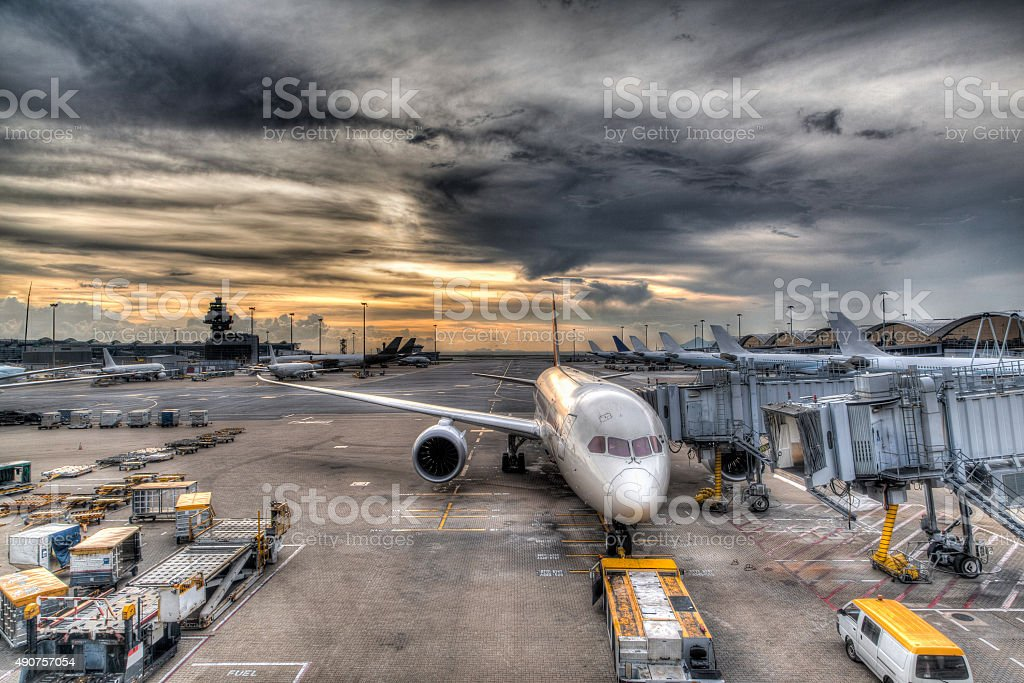 Sunset Over Commercial Aircrafts on Airport Tarmac stock photo
