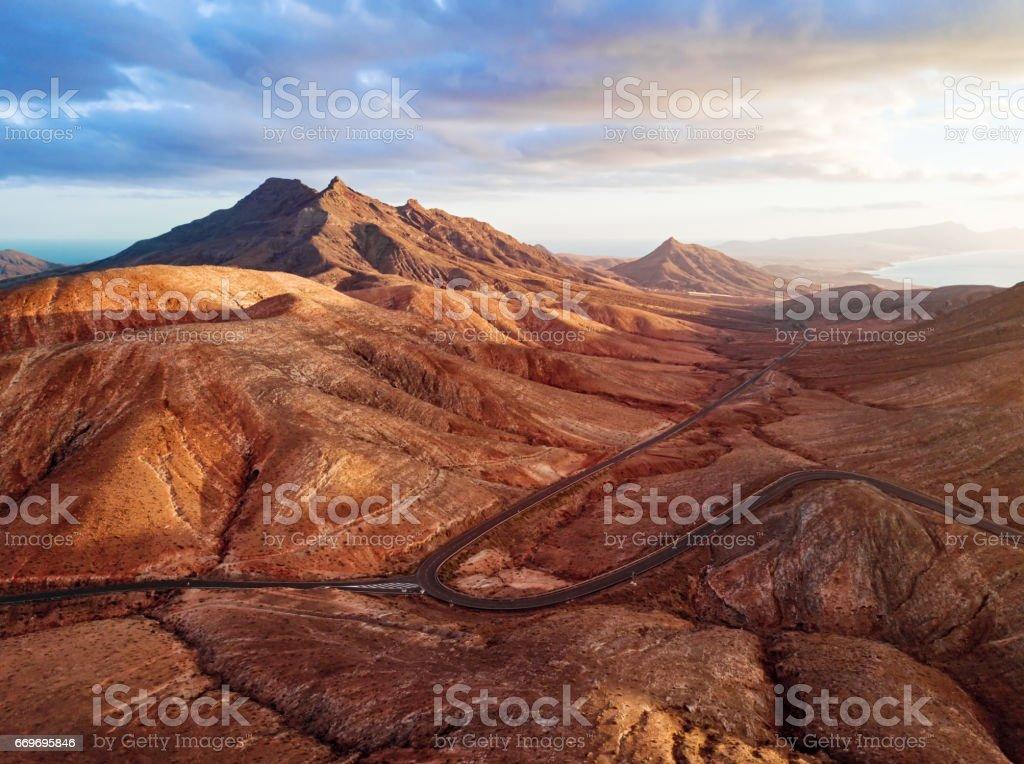 Sunset over desert landscape of Fuerteventura, Canary islands stock photo