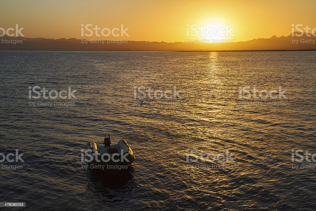 Sunset over dinghy royalty-free stock photo