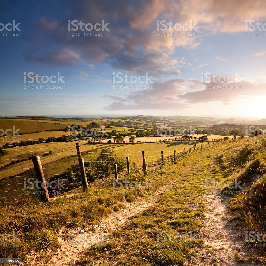 Sunset over English countryside with footpath in Dorset stock photo